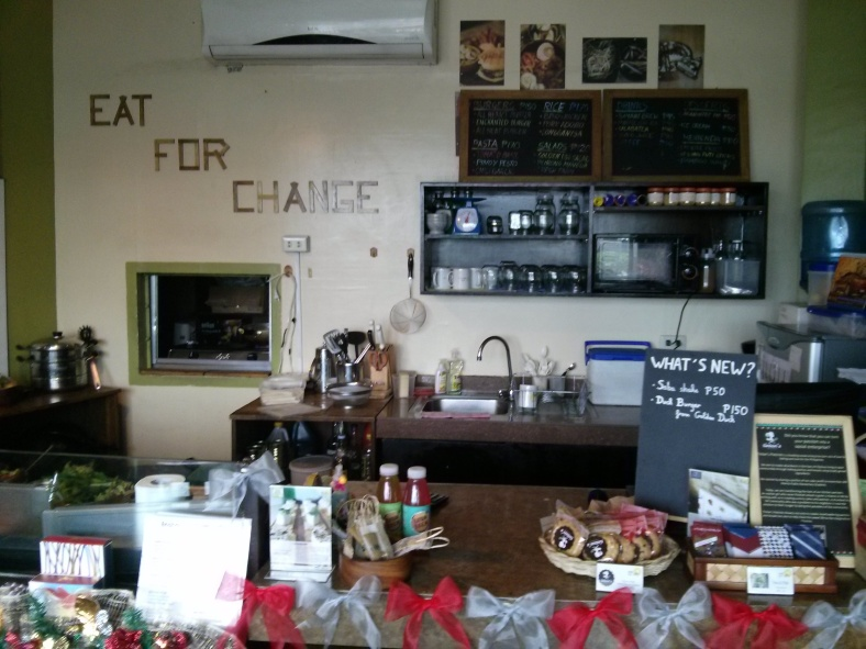 """The Enchanted Farm Cafe invites you to """"Eat for Change""""."""