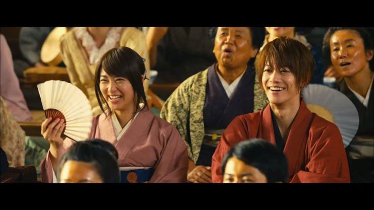 Kaoru and Kenshin enjoy a Bakkyusai play.